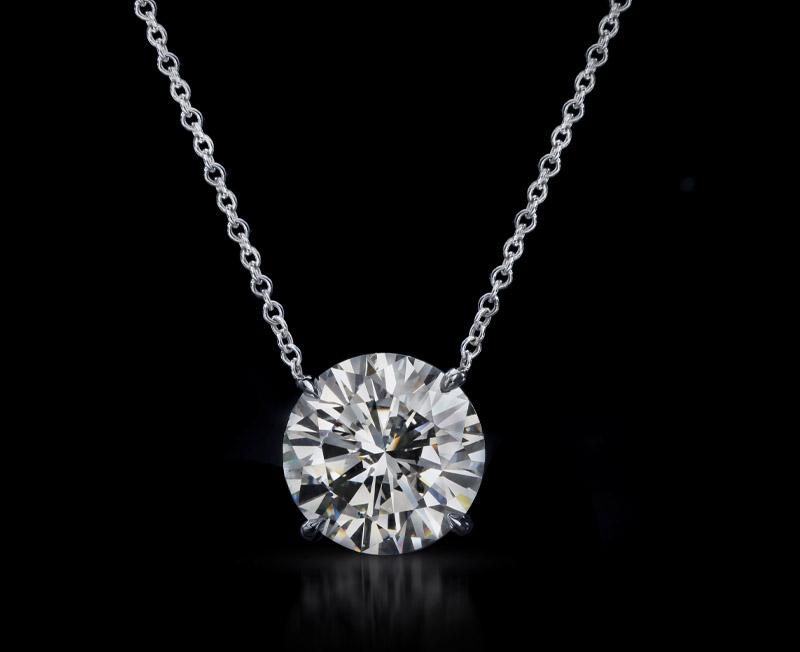 Close-up diamond engagement ring isolated on white background