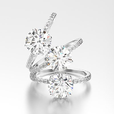 3D illustration three white gold or silver traditional engagement diamond rings with reflection on a white background